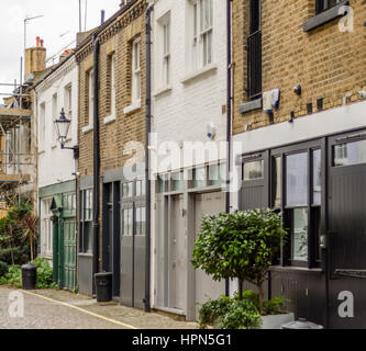 interesting street partially covered with paving stones, low-rise buildings typical of the English quarter, brick - Stock Photo
