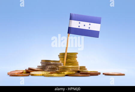 Flag of Honduras in a mixed stack of european coins and a blue background.(series) - Stock Photo