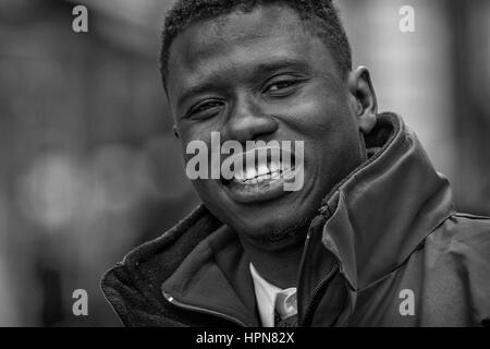Budapest, Hungary - April  11. 2016: Big guy with a big smile at the street posing in front of camera - Stock Photo