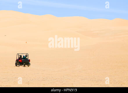 Winterhaven, California, USA - May 26, 2015: Two people driving around in the Algodones Dunes with a buggy. - Stock Photo