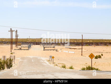Winterhaven, California, USA - May 26, 2015: Dead end road at the fence at the U.S.-Mexico border. - Stock Photo