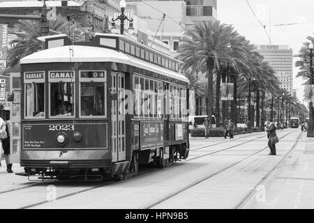 NEW ORLEANS, USA - MAY 14, 2015: Streetcar on Canal Street, in the back another streetcar approaching and people - Stock Photo