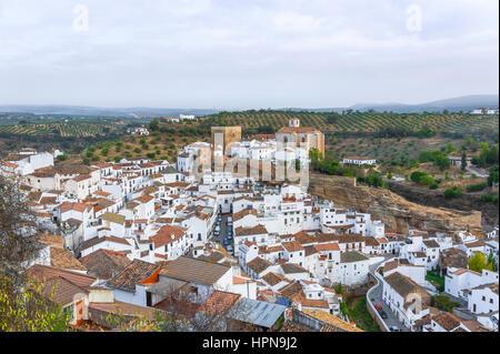 panorama with village Setenil de las Bodegas; white houses under rocks, province of Cádiz, Andalusia, Spain - Stock Photo