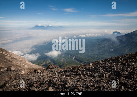 Stunning volcanic landscape viewed from Mount Merapi (Gunung Merapi) a high altitude volcano with a summit at 2,930 - Stock Photo