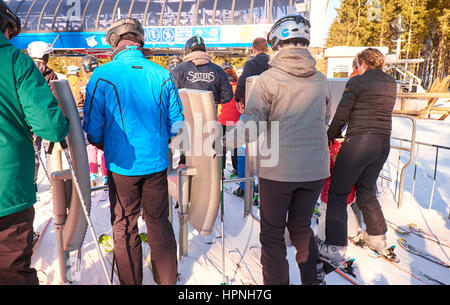 WINTERBERG, GERMANY - FEBRUARY 14, 2017: Skiers going through the pass reader with turnstile at Ski Carousel Winterberg - Stock Photo