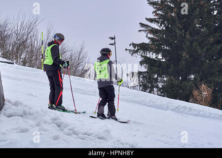 WINTERBERG, GERMANY - FEBRUARY 16, 2017: Young blind downhill skier and his helper on a piste at Ski Carousel Winterberg - Stock Photo