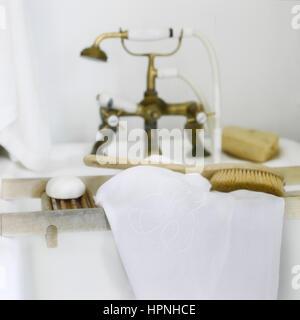Toiletries on a bathtub rack. - Stock Photo