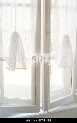 White net curtains on a window. - Stock Photo
