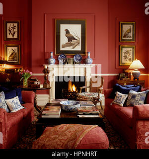 A living room with a fireplace. - Stock Photo