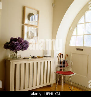 A side table with a metal chair. - Stock Photo
