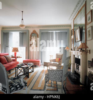 A living room with shutters. - Stock Photo
