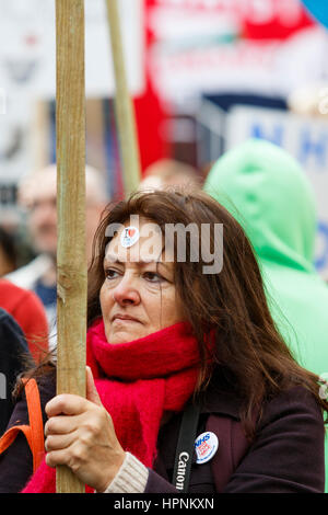 NHS Protesters carrying placards and signs are pictured as they take part in a save our NHS protest march and demonstration - Stock Photo