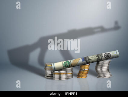 military budget concept, money with gun shadow - Stock Photo