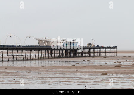 Southport Pier on the sea front, during an un-seasonally warm February day. 22/02/17. - Stock Photo