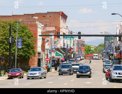 Mount Airy, NC, USA - May 5, 2015: Downtown Mount AIry with signs displaying Spring at the lampposts. There are - Stock Photo