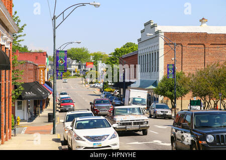 Mount Airy, NC, USA - May 5, 2015: Main Street in downtown Mount Airy with shops and cars. - Stock Photo