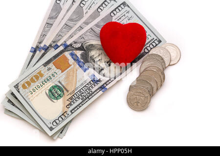 Love of money, cash and coins with red heart shape - Stock Photo