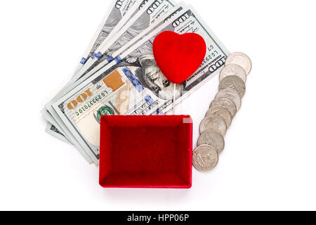 Red gift box and heart shape with money - Stock Photo