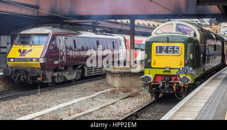 Class 91 Electric train 91101 Flying Scotsman stands beside preserved class 55 Type 5 Deltic diesel D9009 Alycidon - Stock Photo