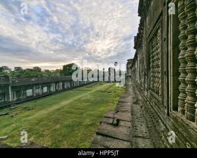 Sunset over inner courtyard at temple ruin angkor wat - Stock Photo