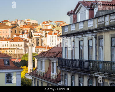 Column of Pedro IV on Rossio Square (Pedro IV Square) in Lisbon, Portugal with surrounding architecture. - Stock Photo