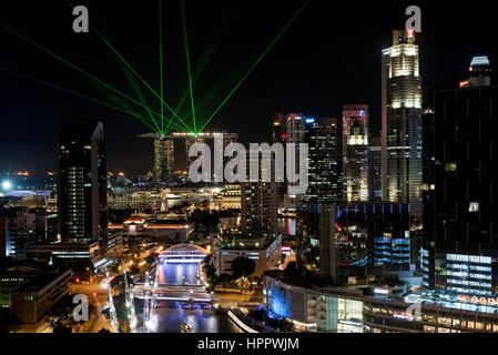 A night view cityscape of the Marina Bay Sands complex with laser lights background and Clarke Quay area skyline - Stock Photo