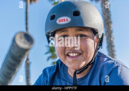 Young BMX riding boy wearing helmet. - Stock Photo