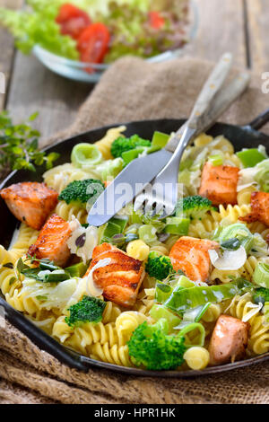 Italian Pasta With Fried Cuts Of Salmon Fillet Horseradish And A Sauce Of Cream And