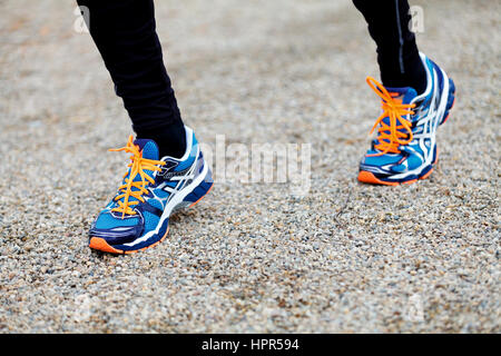 Picture of an athlete feet running on track - Stock Photo