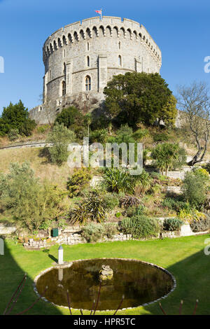 The Round Tower of Windsor Castle, on top of the Motte, & the moat garden seen in February. Windsor, Berkshire. - Stock Photo