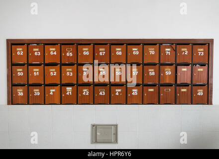 Wooden mailboxes inside the house. - Stock Photo
