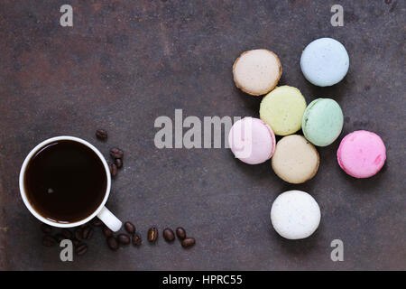 almond biscuits macaroon and a cup of espresso coffee - Stock Photo