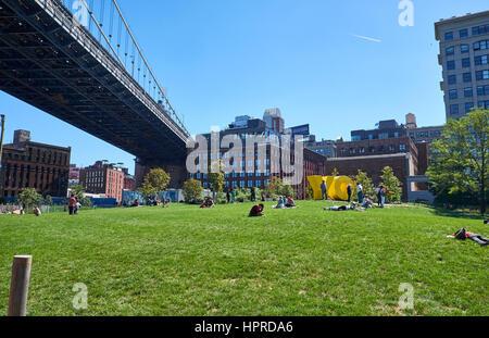 NEW YORK CITY - SEPTEMBER 25, 2016: Main Street Park below Manhattan Bridge in the Dumbo Area of Brooklyn - Stock Photo