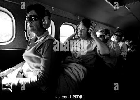 Tourists enjoy a flight-seeing trip around Denali National Park and Mount McKinley in Alaska, United States. - Stock Photo