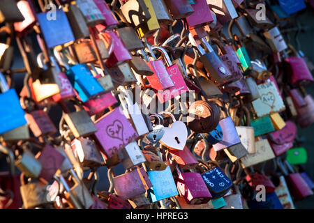 Germany, Cologne, padlocks on fence of footpath of the Hohenzollern railway bridge - Stock Photo