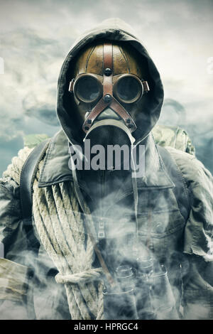Environmental disaster. Post apocalyptic survivor in gas mask - Stock Photo