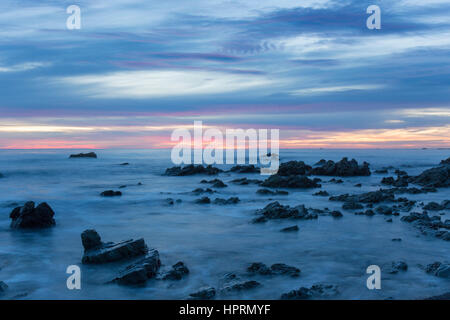 Kaikoura, Canterbury, New Zealand. View across the Pacific Ocean from rocky shoreline at dawn. - Stock Photo