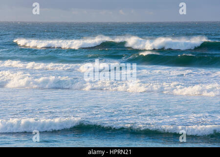 Dunedin, Otago, New Zealand. Powerful waves breaking in the Pacific Ocean off St Clair Beach. - Stock Photo