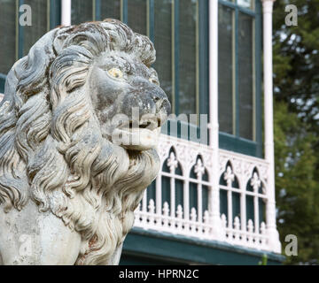 Dunedin, Otago, New Zealand. One of a pair of stone lions standing guard over the main entrance to Larnach Castle, - Stock Photo