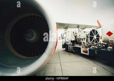 Process of the refueling passenger plane at the airport - Stock Photo