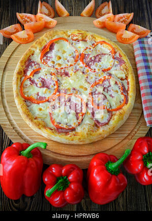 pizza and components lie side by side on the board - Stock Photo