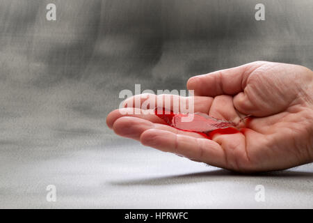 Fortune telling fish. Place on palm of hand and it will react in different ways, depending upon your future. - Stock Photo