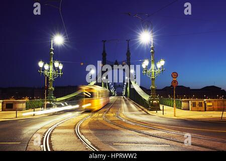 Tram on Liberty Bridge (Freedom Bridge) in Budapest, Hungary - Stock Photo