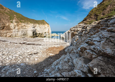 Beautiful pebbly beach at Thornwick bay, Flamborough head on the  east coast of England. A popular tourist destination - Stock Photo