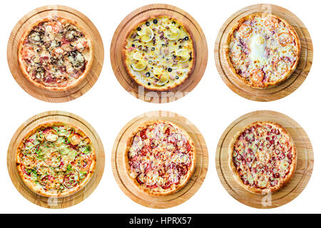 Different kinds of pizza on a white background - Stock Photo