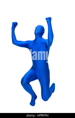 Mysterious blue man in morphsuit rejoice - Stock Photo