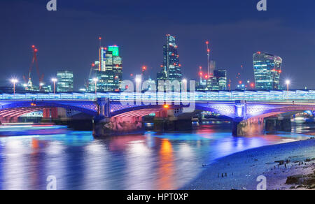 London River Thames night capture against the City of London business district - Stock Photo