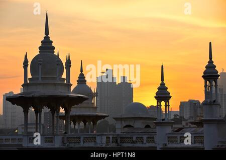 Towers of the historical building railway station in Kuala Lumpur at sunrise. - Stock Photo