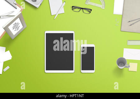 Tablet and smartphone with blank screen for mockup surrounded with stationery and office supplies. Top view off - Stock Photo