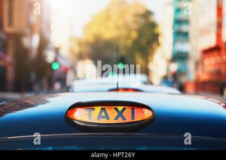 London black taxi cab sign on the street, UK - Stock Photo